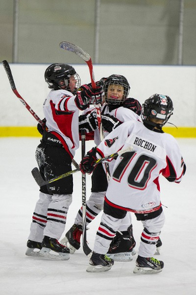 Swat Crushers players Adam Milke (second from right) celebrates his goal against the North Seera Thunder with teammates during 2015 Quikcard Edmonton Minor Hockey Week play at Mill Woods Recreation Centre twin arenas in Edmonton, Alta., on Monday, Jan. 12, 2015. Minor hockey week runs from Jan. 9 - 18, 2015. Ian Kucerak/Edmonton Sun/ QMI Agency