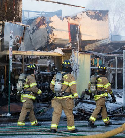 Crews continue to work at the scene of an early morning fire at the Roxy Theatre, 10708 - 124 St., in Edmonton Alta., on Tuesday Jan. 15, 2015. David Bloom/Edmonton Sun/QMI Agency