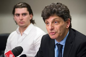 Andrew Creppin, former forward for the University of Ottawa's varsity men's hockey team, and lawyer Lawrence Greenspon. Creppin is making the lawsuit claims on behalf of himself and other members of the 2013-14 hockey team members. They're suing the university for $6M.​ DANI-ELLE DUBE/POSTMEDIA