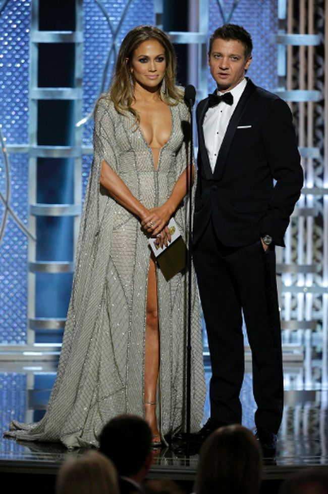 Actors Jennifer Lopez (L) and Jeremy Renner present at the 72nd Golden Globe Awards in Beverly Hills, California January 11, 2015.  REUTERS/Paul Drinkwater/NBC/Handout