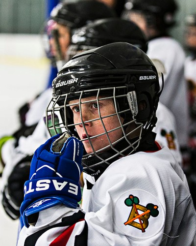 Beaumont Braves' Anden Donohue (in white) watches the action during his team's game against the Knights of Columbus Hurricanes during 2015 Edmonton Quikcard Minor Hockey Week action at Kenilworth Arena in Edmonton, Alta., on Wednesday, Jan. 14, 2015. Codie McLachlan/Edmonton Sun/QMI Agency