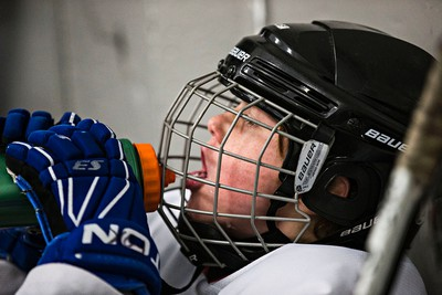 Beaumont Braves' Anden Donohue (in white) takes a drink during his team's game against the Knights of Columbus Hurricanes during 2015 Edmonton Quikcard Minor Hockey Week action at Kenilworth Arena in Edmonton, Alta., on Wednesday, Jan. 14, 2015. Codie McLachlan/Edmonton Sun/QMI Agency