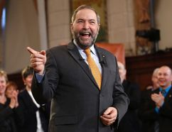 NDP leader Thomas Mulcair receives a standing ovation while delivering a speech to his caucus on Parliament Hill in Ottawa, Jan. 15, 2015. (CHRIS WATTIE/Reuters)