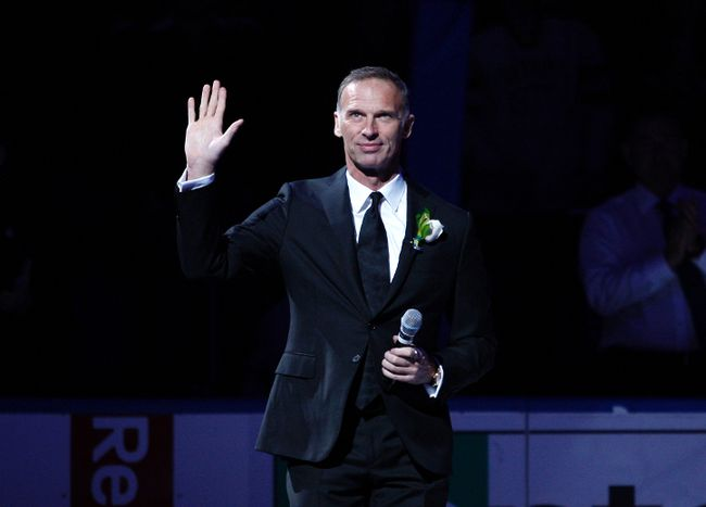Buffalo Sabres former goalie Dominik Hasek waves to the crowd as he takes the ice during his ceremony to get his number retired prior to a game against the Detroit Red Wings at First Niagara Center on Jan. 13, 2015. (Timothy T. Ludwig/USA TODAY Sports)