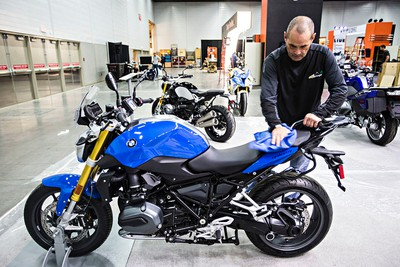 Norm Wells of BMW polishes a BMW R1200R during set up for the 2015 Motorcycle and ATV Show Edmonton in Edmonton, Alta., on Thursday, Jan. 15, 2015. Codie McLachlan/Edmonton Sun/QMI Agency