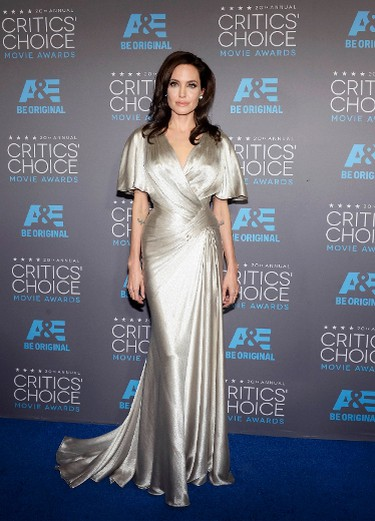 """Angelina JolieGRADE: AAngelina can't go wrong with Atelier Versace Remember that beautiful pink gown from the 2012 Golden Globes? The colour and wrapping in this dress looked stunning.  REUTERS/Kevork Djansezian   PDRTJS_settings_8024650 = { """"id"""" : """"8024650"""", """"unique_id"""" : """"default"""", """"title"""" : """""""", """"permalink"""" : """""""" }; (function(d,c,j){if(!document.getElementById(j)){var pd=d.createElement(c),s;pd.id=j;pd.src=('https:'==document.location.protocol)?'https://polldaddy.com/js/rating/rating.js':'http://i0.poll.fm/js/rating/rating.js';s=document.getElementsByTagName(c)[0];s.parentNode.insertBefore(pd,s);}}(document,'script','pd-rating-js'));"""