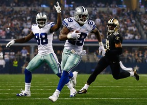 Cowboys running back DeMarco Murray (front) led the NFL in rushing yards, while Dez Bryant topped all receivers with 16 TDs. (AFP)