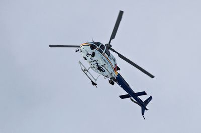 A police helicopter hovers overhead as RCMP officers are on scene after two RCMP officers were shot in St. Albert, Alta., on Saturday, Jan. 17, 2015. (Codie McLachlan/QMI Agency)