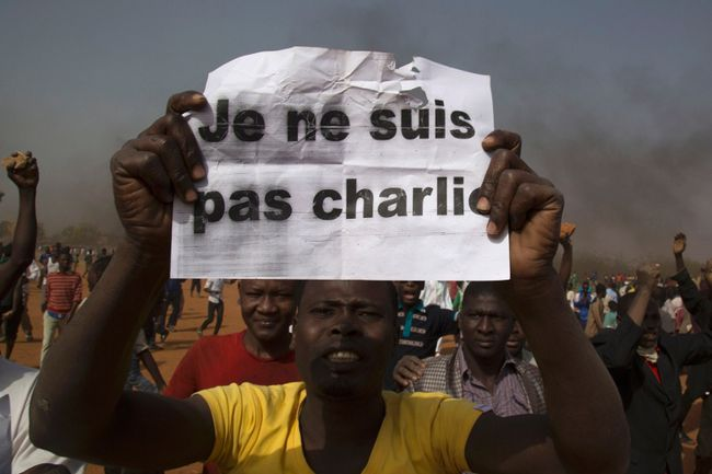 "A man holds a sign during a protest against Niger President Mahamadou Issoufou's attendance last week at a Paris rally in support of French satirical weekly Charlie Hebdo, which featured a cartoon of the Prophet Mohammad as the cover of its first edition since an attack by Islamist gunmen, in Niamey January 17, 2015. The sign reads as ""I am not Charlie"". REUTERS/Tagaza Djibo"