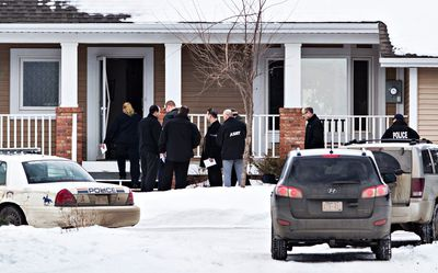 RCMP officers are on scene at a home in Sturgeon County after two RCMP officers were shot in St. Albert, Alta., on Saturday, Jan. 17, 2015. Codie McLachlan/QMI Agency