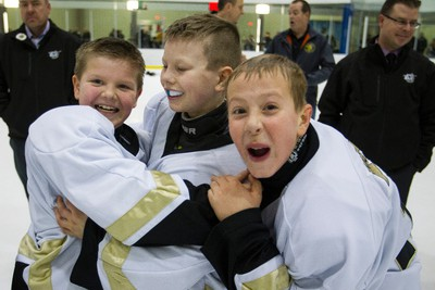 The Atom North east Maple Leafs celebrate their win over the St. Albert Lancers during the final day of play at the 2015 Quikcard Edmonton Minor Hockey Week at Terwillegar Recreation Centre in Edmonton, Alta., on Sunday, Jan. 18, 2015. Ian Kucerak/Edmonton Sun/ QMI Agency