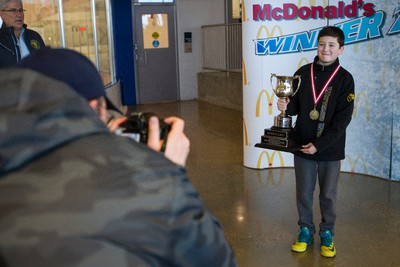 Atom Whitemud West Wolverines Jayden Morin smiles while his dad Jason takes hit photo with the trophy during the final day of play at the 2015 Quikcard Edmonton Minor Hockey Week at Terwillegar Recreation Centre in Edmonton, Alta., on Sunday, Jan. 18, 2015. Ian Kucerak/Edmonton Sun/ QMI Agency