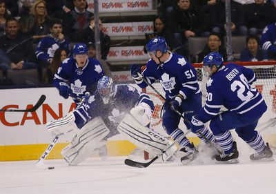 Goalie Jonathan Bernier goes for the puck as Maple Leafs host the Carolina Hurricanes at the Air Canada Centre in Toronto on Monday January 19, 2015. Michael Peake/Toronto Sun/QMI Agency