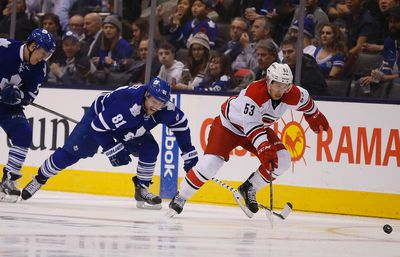 Phil Kessel chases Jeff Skinner s Maple Leafs host the Carolina Hurricanes at the Air Canada Centre in Toronto on Monday January 19, 2015. Michael Peake/Toronto Sun/QMI Agency
