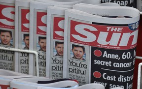 Copies of U.K.'s The Sun newspaper are seen on a newsstand outside a shop in central London Jan. 20, 2015.  REUTERS/Toby Melville