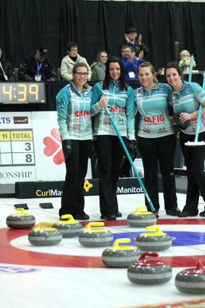 Third Selena Kaatz, Skip Kerri Einarson, Lead Kristin MacCuish and Second Liz Fyfe pose with the eight rocks they counted during their first game of the provincial Scotties Tournament of Hearts in Winkler, Manitoba on January 21, 2015. In what was possibly the first eight-ender in Scotties history, the Kerri Einarson rink beat Dauphin's Tiffany McLean 16-3. (GREG VANDERMEULEN/Winkler Times)
