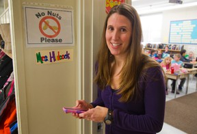 Hillcrest PS teacher Julie Hudecek sends notes home with her pupils, but she also has an app that sends electronic versions to parents. (MIKE HENSEN, The London Free Press)