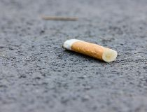 Cigarette butt on the sidewalk