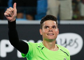 Milos Raonic celebrates after defeating Donald Young of the U.S. in their men's singles second round match at the Australian Open 2015 tennis tournament in Melbourne January 22, 2015. REUTERS/Athit Perawongmetha