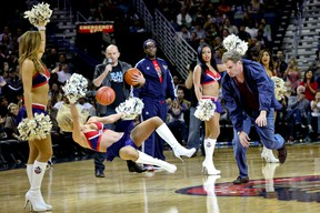 Actor Will Ferrell hits an actress playing a member of the New Orleans Pelicans dance team in the face with a ball during a stunt filmed for the movie Daddy's Home that filmed at halftime of a game against the Los Angeles Lakers at the Smoothie King Center. (Derick E. Hingle-USA TODAY Sports)