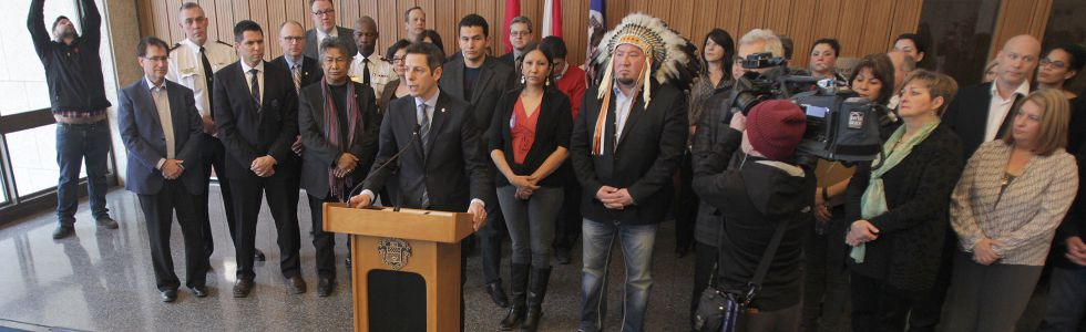Mayor Brian Bowman, flanked by dozens of supporters, spoke against racism in a press conference Jan. 22, 2015 in response to a Maclean's magazine story.