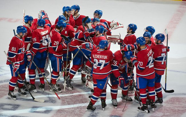 Canadiens players mob defenceman P.K. Subban after he score the overtime winner against the Predators during NHL action in Montreal on Tuesday, Jan. 20, 2015. (Ben Pelosse/QMI Agency)