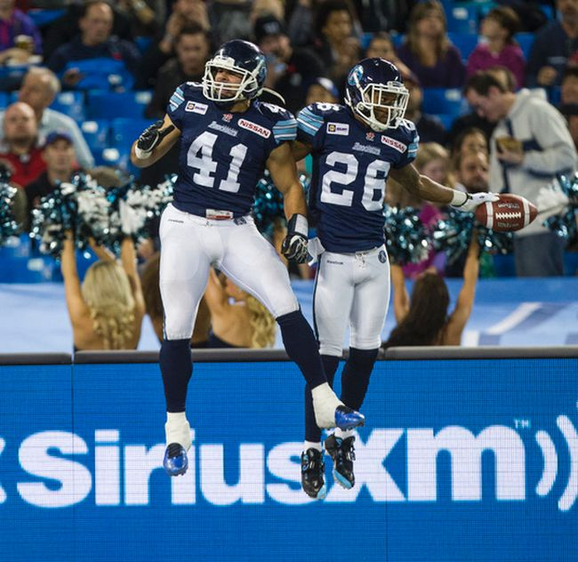 Argonauts' Shea Emry (left) and Branden Smith celebrate a touchdown against the RedBlacks during CFL action in Toronto on Nov. 7, 2014. (Ernest Doroszuk/QMI Agency)