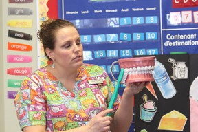 Tennille Needham, a dental hygienist from Spruce Grove, showed 150 Grade 1 and 2 students at École Meridian Heights School in Stony Plain how to properly brush their chompers on Jan. 15. The dental presentation was one of many Needham will make this year. Needham expects to speak to roughly 1,700 students in the Capital Region about proper oral health by the end of the school year. - Karen Haynes, Reporter/Examiner