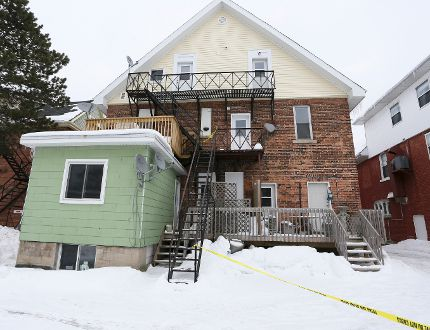 Police tape blocks access to the second-floor fire escape access to an apartment unit at the rear of 862 2nd Ave. W. in Owen Sound Friday. Police on Saturday identified apartment resident Lezleigh Hopkins, 28, as the victim of murder. (James Masters/Owen Sound/QMI)