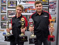 than and Brayden Ochitwa show off some of the trophies they've won over the years at their family garage just outside of town. (Omar Mosleh/La Nouvelle Beaumont News)