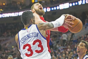 Raptors centre Jonas Valanciunas is fouled during Friday night's game against the Philadelphia 76ers. (USA TODAY SPORTS)