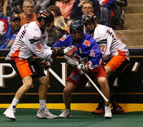 Buffalo Bandits' Kevin Brownell (left) and Dhane Smith try to contain the Rock's Jesse Gamble during Toronto's National Lacrosse League home opener on Jan. 23 at the ACC. (Jack Boland, Toronto Sun)