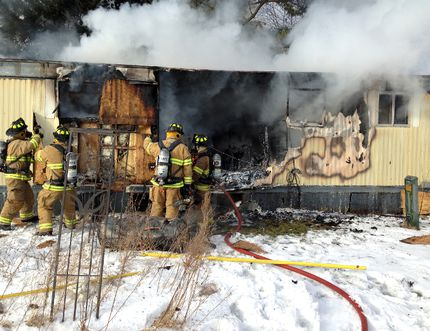 Elizabethtown-Kitley firefighters attend to a Jasper home destroyed by fire Thursday.