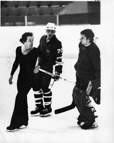 Maple Leafs Jiri Crha (right) and Gary Yaremchuk, out for a practice skate at the Gardens chat with figure skater Toller Cranston. (Toronto Sun files)
