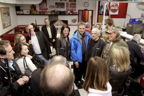 Former Wildrose leader and new PC MLA Danielle Smith and Alberta Premier Jim Prentice pose for a pictures with  High River residents at Evelyn's Memory Lane in High River, Alta., on Saturday January 24, 2015. Mike Drew/Calgary Sun/QMI Agency