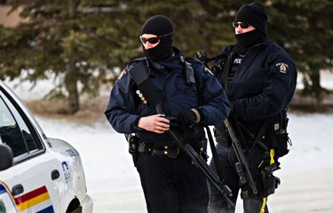 RCMP officers are on scene at Apex Casino after two RCMP officers were shot in St. Albert, Alta., on Saturday, Jan. 17, 2015. RCMP officers, Aux. Const. Derek Walter Bond was injured and and Const. David Matthew Wynn was killed after being shot in the head. Codie McLachlan/Edmonton Sun/QMI Agency