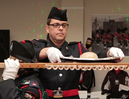 After finishing up some Scottish poetry, Rob Knox places the haggis back onto a ceremonial platter during the fourth Robbie Burns Gala, which was held at the Dante Club Saturday. JEFF LABINE/The Daily Press