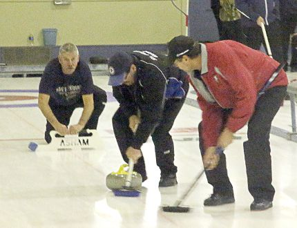 Doug Wiens and Dave Moir sweep a rock thrown by Randy Hilderbrandt during one of their games at the Lake of the Woods Men's Bonspiel at the Kenora Curling Club this past wee