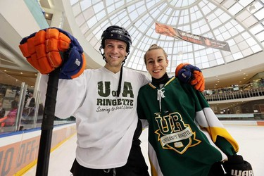 Media player David Pelletier pose for a photo with Danielle Pronovost  after the 2015 Ringette Scores on Cancer Media game at West Edmonton Mall  in Edmonton, Alberta on Sunday Jan.25, 2015. . Perry Mah/Edmonton Sun/QMI Agency