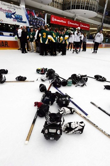 Players dump their equipment on the ice after the 2015 Ringette Scores on Cancer Media game at West Edmonton Mall  in Edmonton, Alberta on Sunday Jan.25, 2015. Perry Mah/Edmonton Sun/QMI Agency