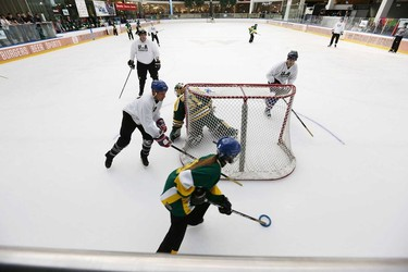 Players battle for the ring during the 2015 Ringette Scores on Cancer Media game at West Edmonton Mall  in Edmonton, Alberta on Sunday Jan.25, 2015. Perry Mah/Edmonton Sun/QMI Agency