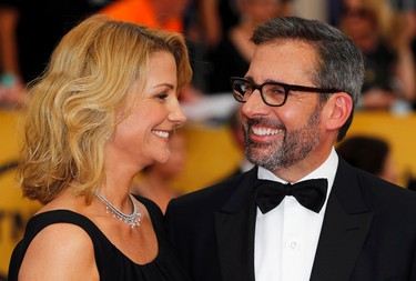 """Actor Steve Carell from the film """"Foxcatcher"""" and his wife, Nancy, arrive at the 21st annual Screen Actors Guild Awards in Los Angeles, California January 25, 2015.  REUTERS/Mike Blake"""