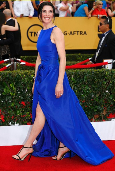 """Actress Julianna Margulies of the CBS series """"The Good Wife"""" poses on arrival at the 21st annual Screen Actors Guild Awards in Los Angeles, California January 25, 2015.  REUTERS/Mike Blake"""