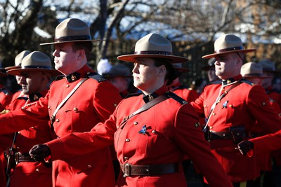 RCMP officers march during the funeral procession for RCMP Const. David Wynn in St. Albert, Alta., on Monday, Jan. 26, 2015. The full regimental regimental funeral is being held at Servus Place in St. Albert. Wynn was killed in a shooting on Jan. 17, 2015 while attempting an arrest at Apex Casino. Ian Kucerak/Edmonton Sun/ QMI Agency