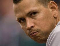 New York Yankees' Alex Rodriguez watches from the dugout railing during the 11th inning of their MLB American League baseball game against the Tampa Bay Rays in St. Petersburg, Florida, in this August 25, 2013 file photo. (REUTERS/Steve Nesius/Files)