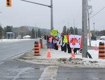 Members of the UUWS take to the highway intersection for their fourth rally on Jan. 22 after an inquiry to lo
