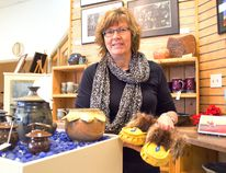 Portage and District Arts Centre executive director Lori Blight shows off some of the items on display at the centre's gift shop. (Svjetlana Mlinarevic/The Graphic/QMI Agency)
