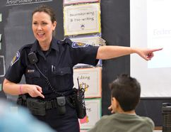 London police Const. Sandasha Ferguson talks to Shannon Coombs' Grade 6 class at Holy Family Catholic elementary school Tuesday. (CRAIG GLOVER, The London Free Press)