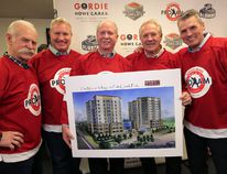 NHL alumni (from left) Lanny McDonald, Marty McSorley, Darryl Sittler and Perry Berezan join Gordie Howe's son, Marty Howe, (middle) at the Saddledome in Calgary on Tuesday to announce the 2015 Gordie Howe C.A.R.E.S. Hockey Pro-Am tournament benefactor. Proceeds from this year's event will go to the Gordie Howe C.A.R.E.S. (Centre for Alzeimer's Research and Education Society) through the Flames Foundation for Life. The funds will also help operate the Gordie Howe Center for Dementia Care currently under construction in south Calgary, of which they are holding a picture. Photo by Stuart Dryden/Calgary Sun.