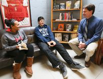 St. Mary's High School principal Murray Kuntz chats with students Shairissa Robichaud and Tyrell Nadjiwon in the school library. (James Masters The Sun Times)